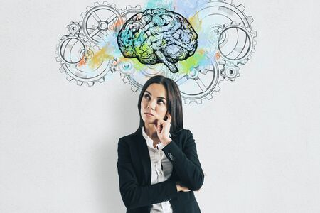 Businesswoman thinking. Abstract brain and gears. Perspective and intelligence concept. Reklamní fotografie
