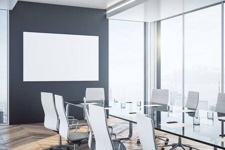 Coworking meeting room with blank banner on wall and daylight. 3D Rendering