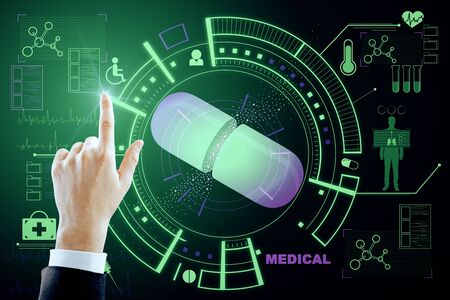 Medicine and technology concept. Hand using creative glowing blue medical interface on dark background.