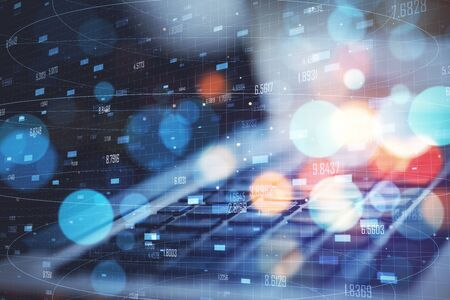 Big data and technology concept. Close up of laptop with creative digital numbers mesh on blurry bokeh background. Double exposure 写真素材