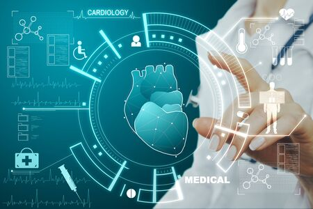Cardiology and science concept. Doctor hand using creative glowing medical interface hud hologram on blue background. Multiexposure Banco de Imagens