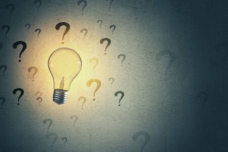 Lightbulb and drawing question mark on grey concrete wall background. Success and startup concept. 3D Rendering