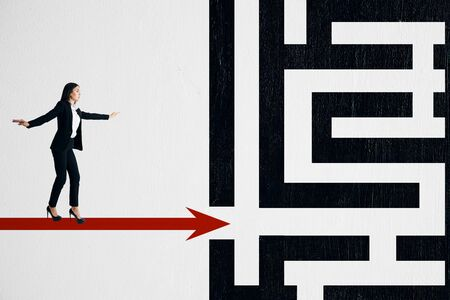 Young european businesswoman walking on creative labyrinth. Maze and solution concept