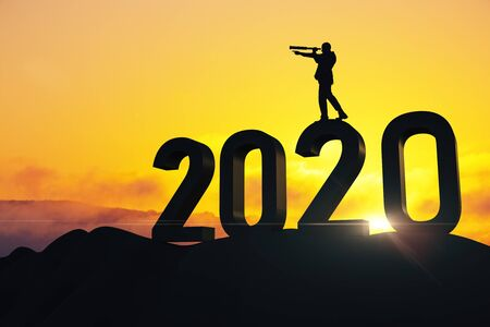 Businessman with telescope standing on 2020 new year text. Success and startup concept. Stok Fotoğraf