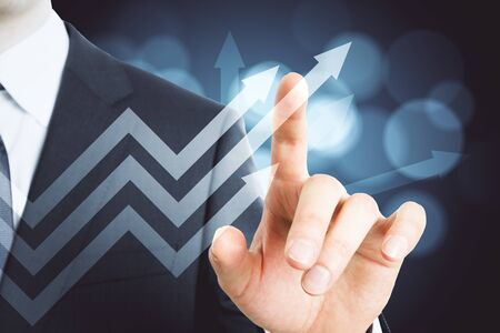 Businessman hand pointing glowing stock arrow. Trade and analysis concept. Multiexposure