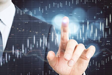 Businessman hand pointing glowing blue forex chart. Trade and analysis concept. Multiexposure
