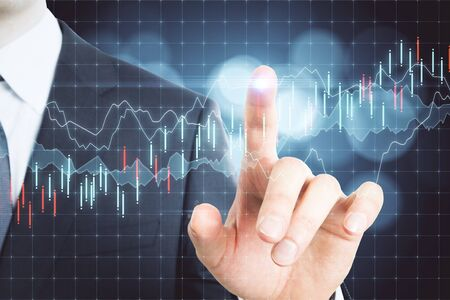 Businessman hand pointing glowing stock statistics. Trade and analysis concept. Multiexposure