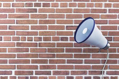 Old loud speaker on red brick wall background. 3D Rendering