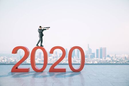 Businessman with telescope standing on red 2020 new year text on buildings background. Success and startup concept.