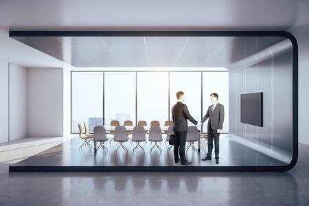 Businessmen shaking hands in modern office interior with city view and plasma on wall. Partnership and success concept.