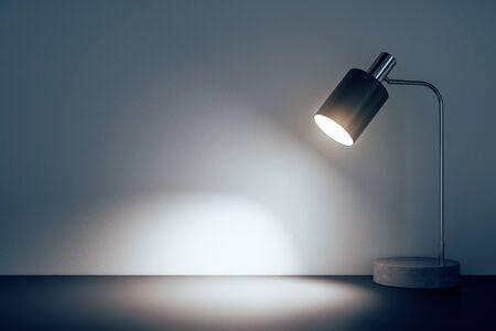 Biurowa lampa stołowa na podłodze w pomieszczeniu betonowym. Renderowanie 3D