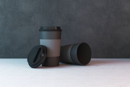 Two black paper coffee cups on table. 3D Rendering Stok Fotoğraf