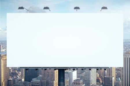 Blank white billboard on city background. Public ad and business concept. Mock up
