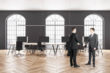 Business people shaking hands in modern         office interior with city view. Stok Fotoğraf