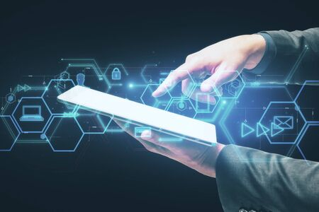 Businessman using tablet with abstract digital business interface. Innovation and technology concept.
