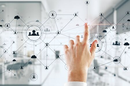 Businessman hand using social network interface and glowing human resource concept. Close up