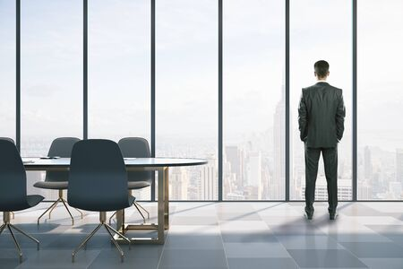 Businessmen standing in modern coworking meeting room. Occupation and worker concept.