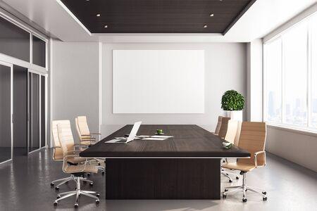 Oficina de coworking contemporánea con ordenador portátil y cartel en blanco en la pared. Representación 3D Foto de archivo