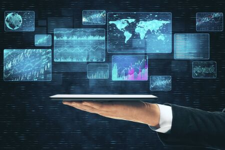 Businessman hand holding tablet with digital business interface. Global business and media concept. Close up