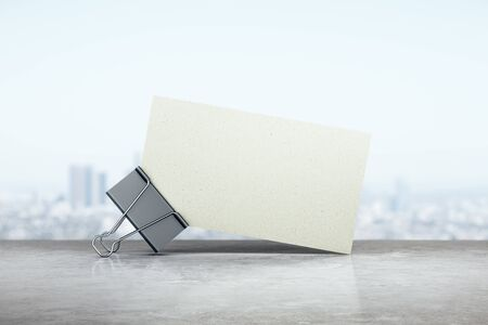 Business card stack with metal clip on city backgroung. Info and address concept. Mock up, 3D Rendering