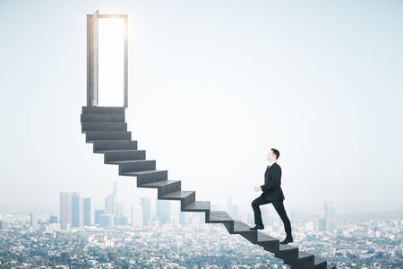 Businessman walking on ladder to success megapolis city view background. Leadership and success concept