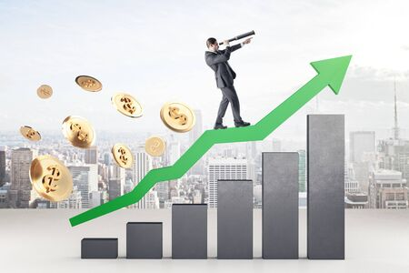 Businessman standing on green arrow with stock chart and golden dollar coins. Success and startup concept.