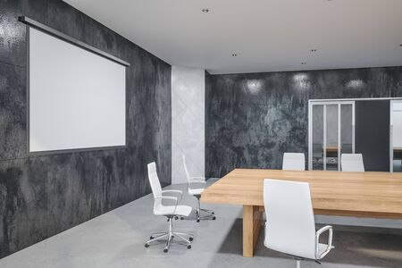 Minimalistic meeting office interior with screen for projector on wall, wooden table and chair. Business and presentation concept. 3D Rendering Stockfoto