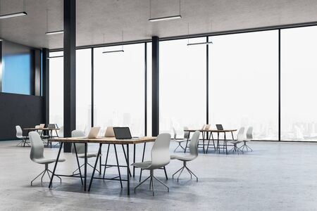 Cozy workplace interior with laptops on table and city view. Workplace and corporate concept. 3D Rendering