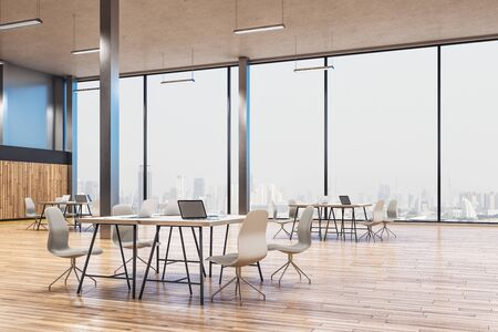 Minimalistic workplace interior with laptops on table and city view. Workplace and corporate concept. 3D Rendering