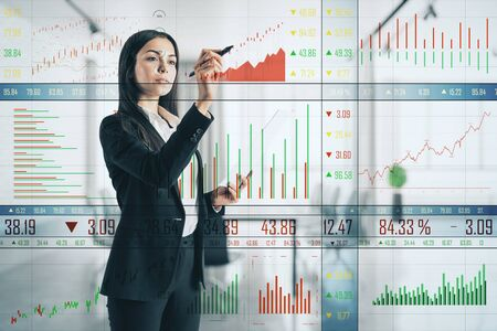 Businesswoman drawing creative business chart on virtual screen. Finance and stock concept