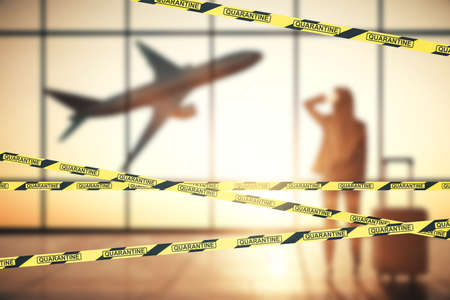 Businesswoman standing in creative airport interior with flying by airplane with yellow and black stripes. Coronavirus quarantine concept.