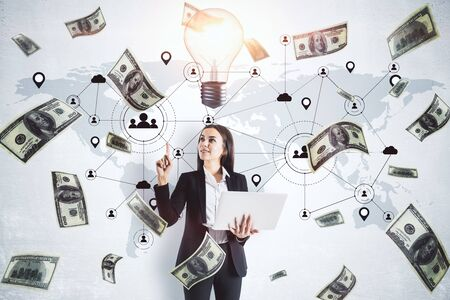 Businessman holding laptop and falling dollar banknotes with cloud email hologram. Business and financial success concept.