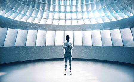 Hacker standing in futuristic interior with abstract wall and window in ceiling. Performance and presentation concept. 3D Rendering