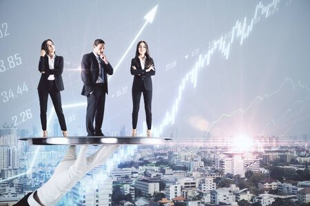 Businesspeople standing on plate and stock chart hologram on city background. Cloud computing and trade concept.