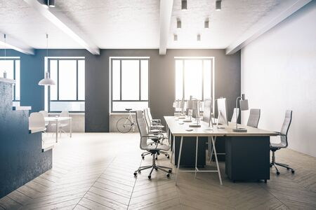 Loft office room with personal computers on table and city view. Workplace and lifestyle concept. 3D Rendering