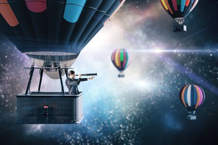 Businessman in air balloon with telescope flies in space. Business and research concept. Foto de archivo - 150367275
