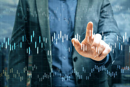Businessman hand pointing at stock chart interface on virtual screen. Trade and finance concept. Double exposure