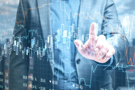 Businessman using stock chart interface on abstract city background. Success and trade concept. Multiexposure