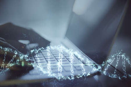 Close up of hand typing on keyboard laptop with digital dna spiral hologram. Technology and trade concept. Double exposure 版權商用圖片