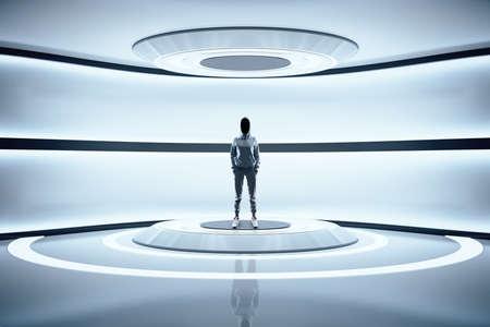 Hacker standing in futuristic interior with neon lamps. Future and design concept. Mock up. Standard-Bild