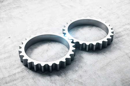 Two metal cog gears on concrete table. Business and teamwork concept. 3D Rendering Reklamní fotografie
