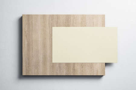 Blank yellow banner hanging on wooden placard on concrete wall. Museum and exhibition concept. Mock up, 3D Rendering