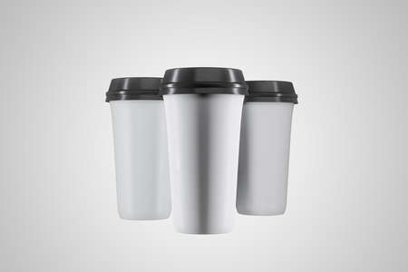 Disposable three white paper cup of coffee on gray background. Food and drink concept. 3D Rendering