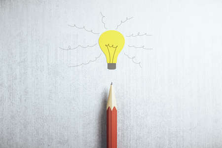Drawing yellow light bulb and pencil on gray table. Idea and startup concept. 3D Rendering Reklamní fotografie