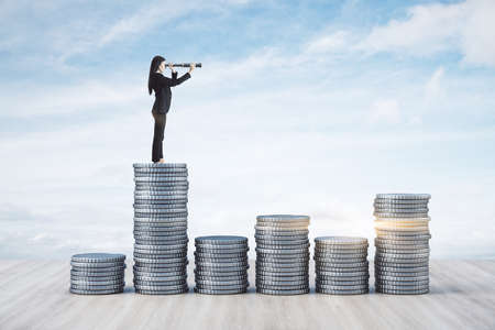 Businesswoman with telescope standing on silver coins on blue sky background. Research and startup concept.