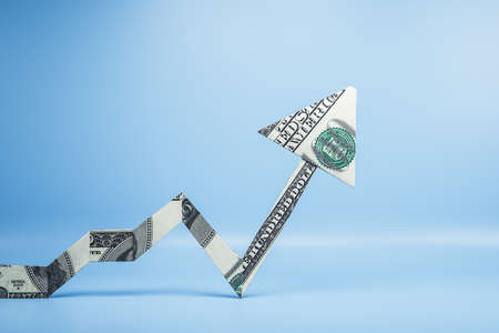 Arrow made of dollars on blue background. Success and startup concept. 3D Rendering