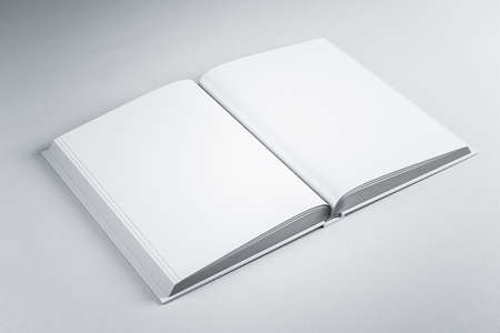 Open book standing on gray table. Publish and advertisement concept. Mock up, 3D Rendering Reklamní fotografie