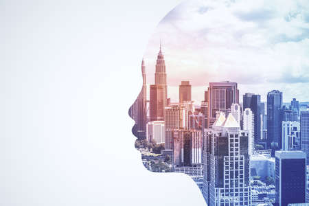 Abstract head silhouette on blurry city background. AI and architecture concept. Double exposure