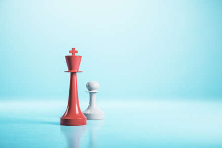 Red king chess piece and white pawn on blue background. Game and challenge concept. 3d rendering