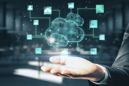 Cloud computing concept with digital screen with glowing cloud and application icons above man hand at abstract background